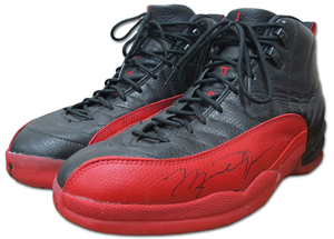 Sneakers Michael Jordan wore during Game 5 of the 1997 NBA Finals, known historically as the 'Flu Game.' Autographed and gifted to Utah Jazz ball toy Preston Truman after the game. Auctioned for a record-setting $104,765. Grey Flannel Auctions image.