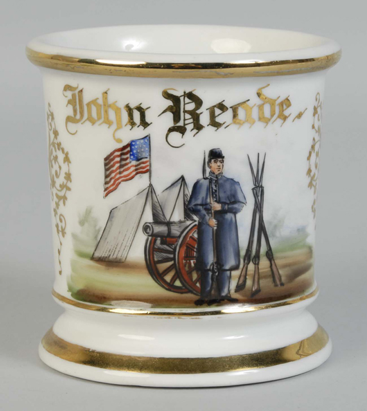 Shaving mug with motif featuring Civil War soldier, cannon, tents, American Flag and crossed rifles, $3,600. Morphy Auctions image.
