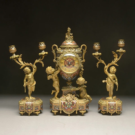 Louis XV-style champleve enamel and gilt bronze clock garniture and matched pair of candelabra, Tiffany & Co., circa 1900. Price realized: $17,700. Michaan's Auctions image.