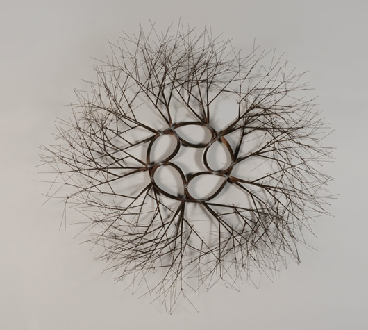 Ruth Lanier Asawa, wire sculpture, tied wire branching wall mounted wreath. Price realized: $102,660. Michaan's Auctions image.