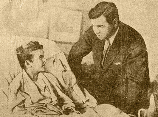 Archival newspaper image of Babe Ruth visiting Little Johnny Sylvester's bedside on October 11, 1926. Grey Flannel Auctions image.