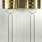 Finnish brass floor lamps, Paavo Tynell. Price realized: $58,800. Woodbury Auction image.