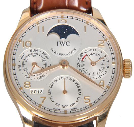 Stunning International Watch Co. perpetual calendar 18K rose gold man's wristwatch (est. $15,000-$20,000). Fontaine's Auction Gallery image.