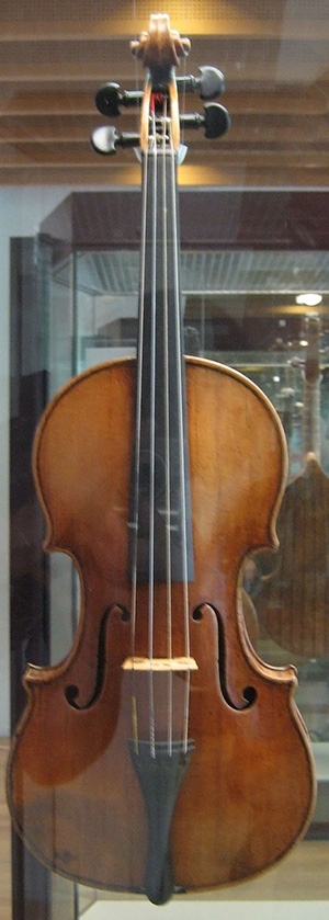A violin crafted by Antonio Stradivari in 1703, on display at the Musikinstrumenten Museum in Berlin. Image by User:Husky. This file is licensed under the Creative Commons Attribution-Share Alike 3.0 Unported license.