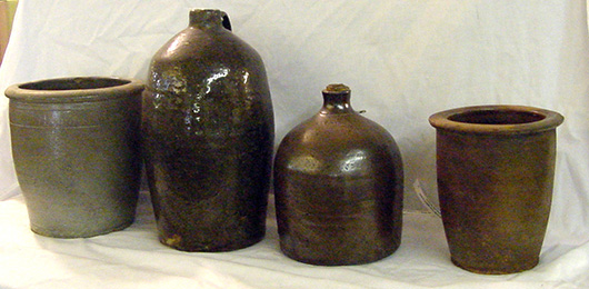 Southern folk pottery including pieces by M. P. Harmon, Mohawk, Tenn.; William Long, Crawford County, Ga.; J.A. Bishop, Georgia. Also includes rare pots by W.W. McFarland and Hull, Mohawk, Tennessee. John W. Coker Auctions image.