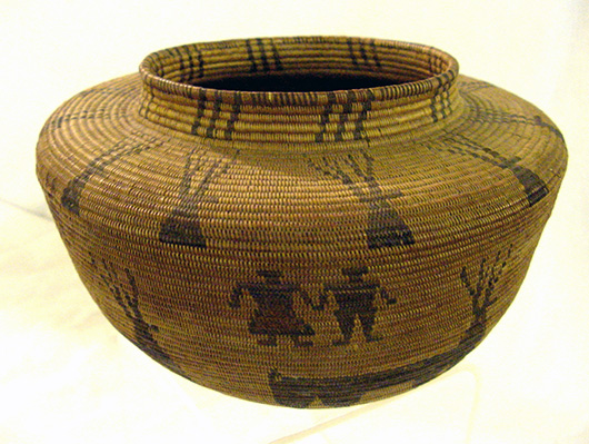 Western Indian basket whose motif includes human figures and deer. John W. Coker Auctions image.