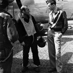 Maj. Jimmy Stewart, right, confers with a B-24 crew member in 1943. U.S. Air Force Image courtesy of Wikimedia Commons.
