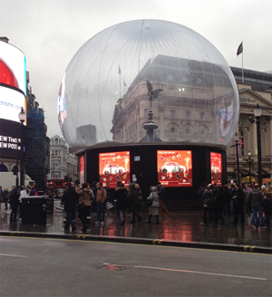 Sir Alfred Gilbert's famous Eros statue in Piccadilly Circus enclosed in a snow-glove as part of the Christmas festivities. Image Auction Central News.