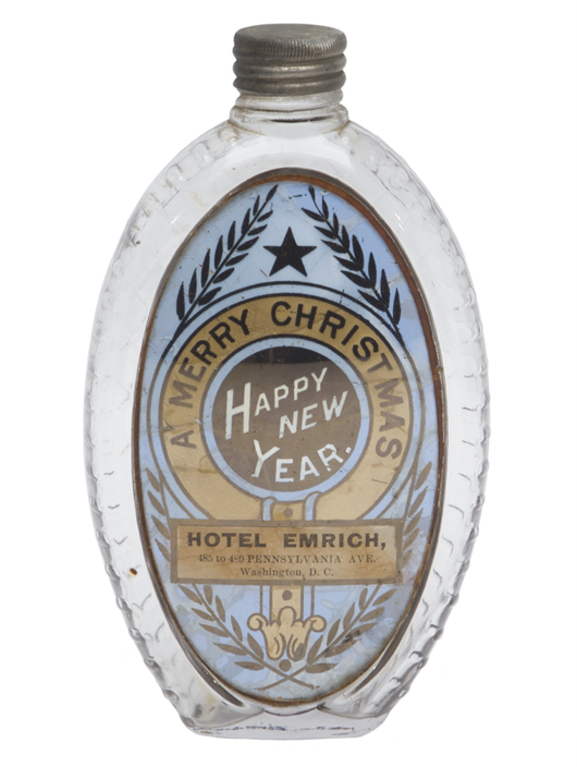 'A Merry Christmas, Happy New Year, Hotel Emrich, 485 to 489 Pennsylvania Ave., Washington, D.C.' is the wording on the label under glass on this antique holiday gift flask. It once held a half pint of whiskey. The bottle sold for $468 at an online Norman C. Heckler bottle auction.