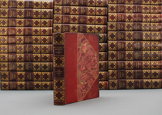 Charles Dickens 32-volume set with author-signed check. Estimate $1,500-$2,500. Waverly Rare Books image.