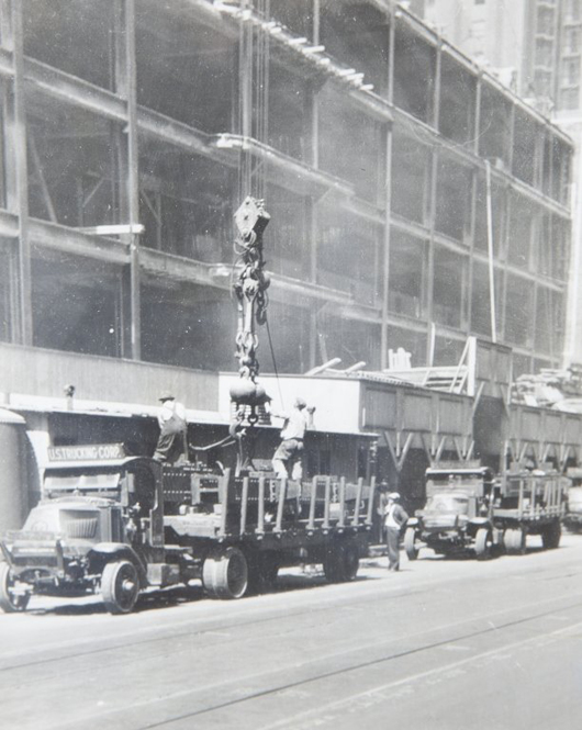 Lewis Wickes Hines (1874-1940), vintage gelatin photograph 'Unloading the Trucks' from 1930-31 Empire State Building Series. Estimate $2,000-$3,000. Quinn's Auction Galleries image.