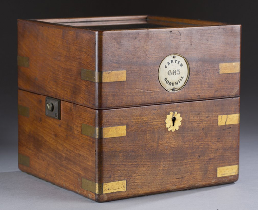 Mahogany and brass case that houses the John Carter ship chronometer. Estimate $5,000-$7,000. Quinn's Auction Galleries image.
