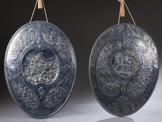 Pair of 19th-century silver-plated bas-relief Elkington wall medallions with scenes from 'Paradise Lost.' Estimate $2,000-$4,000. Quinn's Auction Galleries image.