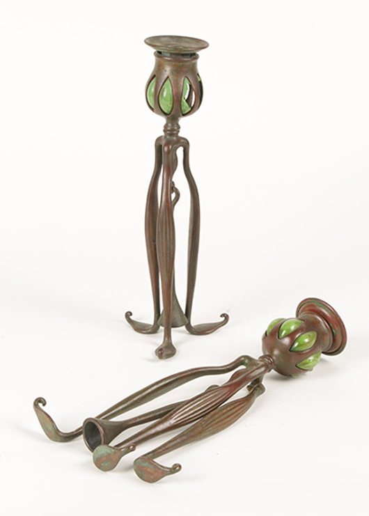 Lot 105 - Tiffany Studios bronze and glass Art Nouveau candlesticks, circa1910. Kamelot Auction House image.