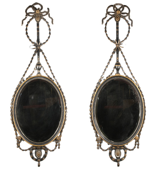 Lot 825 - pair of Adams style gilt decorated painted mirrors having ribbon garland and oval frames around beveled mirrors, circa 1910. Kamelot Auction House image.
