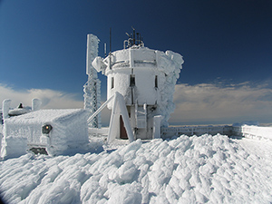 The Mount Washington Observatory summit weather station coated in a thick layer of rime ice, which forms when fog freezes. With an average annual temperature of just 27 degrees and cloud cover two-thirds of the time, Mount Washington has prolific rime icing much of the year. Mount Washington Observatory image.