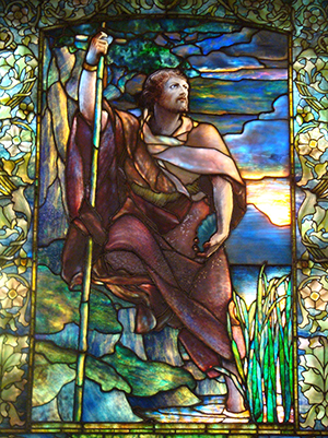 Detail of stained glass window created by Louis Comfort Tiffany in Boston's Arlington Street Church depicting John the Baptist. Photo by John Stephen Dwyer. This file is licensed under the Creative Commons Attribution-Share Alike 3.0 Unported license.