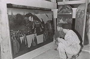 Lt. Daniel J. Kern and German conservator Karl Sieber examining Jan van Eyck's 'Adoration of the Mystic Lamb,' also known as the Ghent Altarpiece (1432). Thomas Carr Howe papers, Archives of American Art, Smithsonian Institution. Photo courtesy of Archives of American Art, Smithsonian Institution.