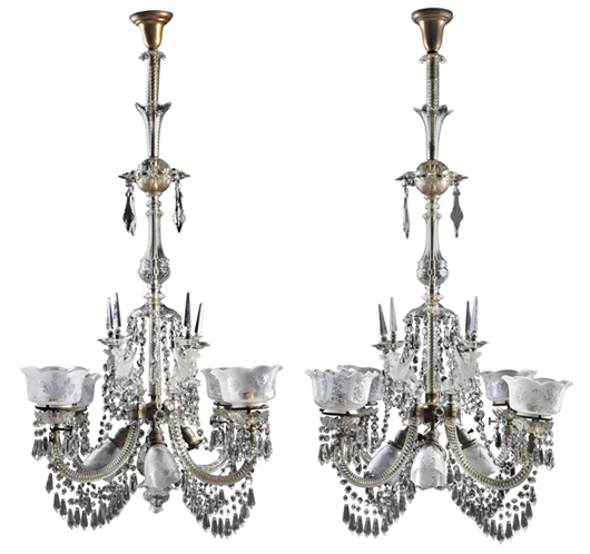 Rare pair of cut crystal gasoliers from around 1900, possibly Baccarat, electrified, 59 inches tall. Crescent City Auction Gallery image.