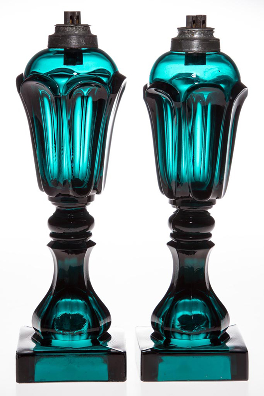 Lot 37: pair of pressed Loop/Leaf stand lamps, brilliant deep peacock-green, circa 1840-1860, Boston & Sandwich Glass Co. Price realized: $9,775. Jeffrey S. Evans & Associates image.