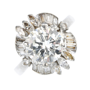 Lot 137, diamond ring stands with a center stone of 2.69 carats and 1 carat of surrounding stones. Fellows image.