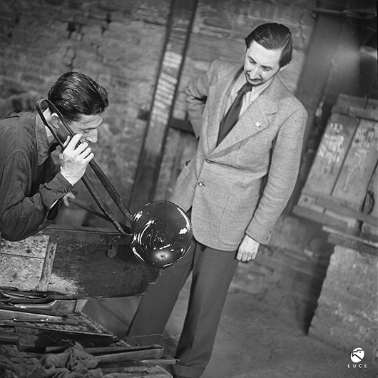 From 1932 to 1947, Carlo Scarpa (1906-1978) served as artistic director at the Venini Glassworks, where he developed innovative techniques that reinvigorated Venetian glassmaking. Scarpa (right) is shown with glassmaker Arturo Biasutto at the factory in an archival photo from 1943. Archivio Storico Luce. Photo courtesy Metropolitan Museum of Art.