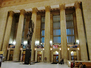 The Pennsylvania Railroad World War II Memorial, featuring the sculpture 'Angel of the Resurrection' by Walker Hancock, is inside the main entrance to the 30th Street Station in Philadelphia. Image by Beyond My Ken. This file is licensed under the Creative Commons Attribution-Share Alike 3.0 Unported, 2.5 Generic, 2.0 Generic and 1.0 Generic license.