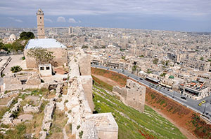 Aleppo from the Citadel, the medieval fortified palace in the centre of the old city in northern Syria. Image by anjci. This file is licensed under the Creative Commons Attribution 2.0 Generic license.