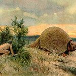 The Clovis culture inhabited the Americas during the final glacial episodes of the late Pleistocene period. Known as Paleo-Indians because of the appearance of their 'lithic flaked' stone tools, they were the earliest settlers in North America. This circa-1920 painting by Heinrich Harder (German, 1858-1935) depicts Paleo-Indians hunting a glyptodont. Image is in the public domain in the United States because its copyright term of the life of the author plus 70 years has expired.
