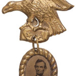 This 1884 badge is a valuable memento honoring President Abraham Lincoln. The picture of the president is a ferrotype (a photograph, often called a tintype, made on a thin sheet of iron) mounted in a 5/8-by-1/2-inch brass frame hung on an eagle-shaped hanger. The badge could be pinned on a suit or a dress. Heritage Auctions of Dallas sold it for $1,375 in November 2013.