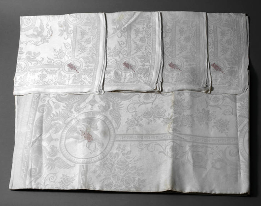This stately linen damask tablecloth and 12 napkins, circa 1880, is embroidered with a red 'HH' monogram. Photo courtesy Auktionshaus Mehlis.