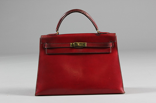 Hermes burgundy leather Kelly bag, 1960s, stamped in gold: Hermes Paris, with padlock, keys, remains of fob. Estimate £600/800. From Kerry Taylor Auction's February 25, 2014 Vintage Fashion sale, London. Kerry Taylor Auctions image.
