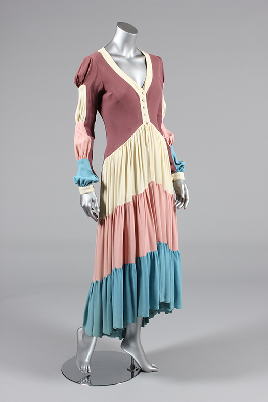 Ossie Clark Traffic Light dress, 1970; mauve moss-crêpe bodice with cream, pink and blue tiered, graduated flamenco style skirt and sleeve panels. Estimate  £400/600. From Kerry Taylor Auction's February 25, 2014 Vintage Fashion sale, London. Kerry Taylor Auctions image.