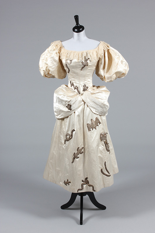 Ivory satin witch costume, circa 1885, labeled 'Miss Shannon Costumier, Sligo,' the dress with high-relief sequined silver motifs (owl, bat, lizards, snakes, lightning bolt, etc.) comprising boned bodice, polonaised short skirt and capelet. Estimate £200/300. From Kerry Taylor Auction's February 25, 2014 Vintage Fashion sale, London. Kerry Taylor Auctions image.
