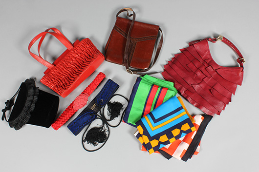 Group of Yves Saint Laurent bags and belts, 1970s-80s, including Russian Collection blue suede belt, black velvet evening bag, three leather bags and three silk scarves. Estimate  £100/150. From Kerry Taylor Auction's February 25, 2014 Vintage Fashion sale, London. Kerry Taylor Auctions image.