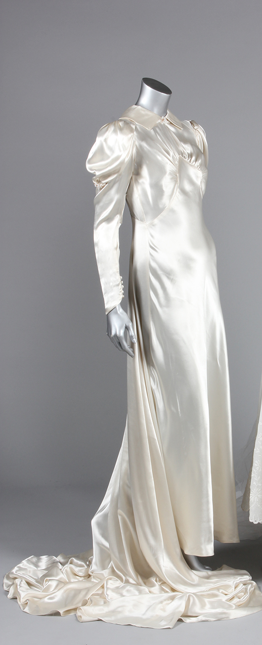 Bias-cut white satin with high neck and long train, late 1930s. (part of a group lot of bridalwear). Estimate: £200/300. From Kerry Taylor Auction's February 25, 2014 Vintage Fashion sale, London. Kerry Taylor Auctions image.