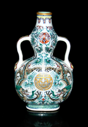 Doucai dragon double-gourd flask of compressed form, with bat medallion below a gilt rim and a Shou symbol defined by descending dragons in an overall pattern of feathery foliage on undulating stems. Lot 185. Estimate: $500,000-$800,000. Gianguan Auctions image.