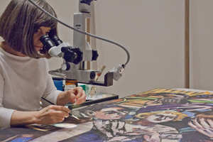 Joan Gorman of the Midwest Art Conservation Center working on the Max Beckmann painting. Photo: Minneapolis Institute of Arts.