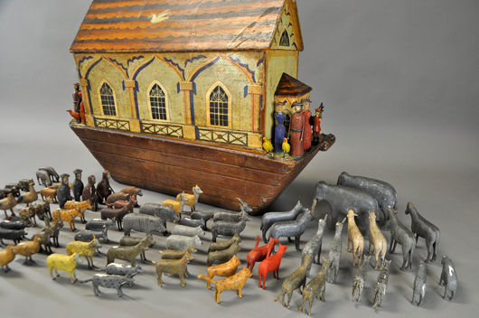 Hand-painted Noah's Ark with extensive array of carved figures representing people and pairs of animals, 37in long, est. $12,000-$14,000. Bertoia Auctions image.