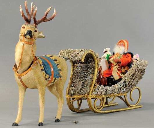 Clockwork reindeer nodder with Santa on sleigh, 30in overall, est. $6,000-$8,000. Bertoia Auctions image.