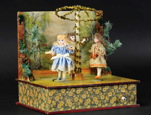 Maypole toy with three girl figures with bisque heads and composition bodies, German, crank action, circa 1900, est. $2,000-$2,750. Bertoia Auctions image.