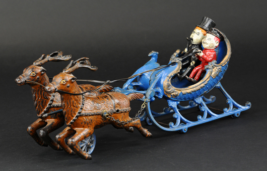 Hubley cast-iron sleigh with two Brownie figures, 16in long, est. $2,500-$3,500. Bertoia Auctions image.