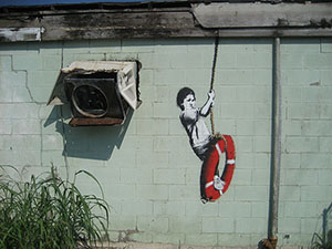 'Swinger,' one of the Banksy murals in New Orleans. Image by Infrogmation of New Orleans. This file is licensed under the Creative Commons Attribution 2.0 Generic license.
