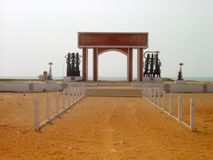 Gateway of No Return, a massive monument to the area's bleak history as a slave trading hub. Image by rgrilo. This file is licensed under the Creative Commons Attribution 2.0 Generic license.