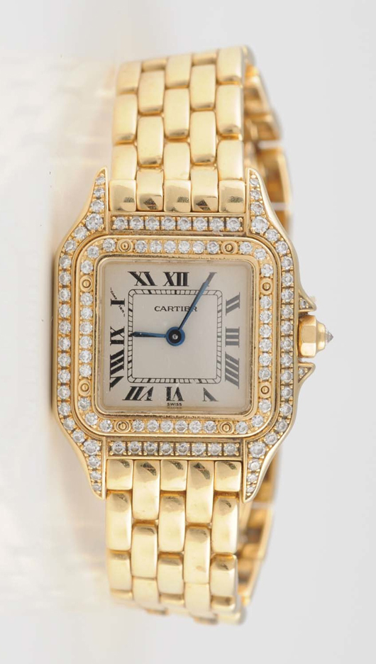 Cartier 18K yellow gold ladies diamond watch, est. $2,500-$3,500. Morphy Auctions image.