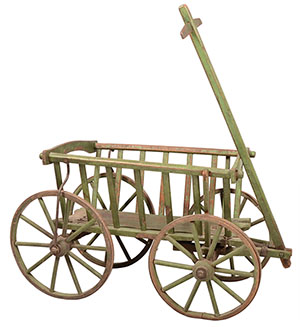 In the 19th century, this wooden cart was used on a farm. The goat wagon has iron-banded wooden wheels. It is 21 inches wide and 40 inches long. The cart sold for $236 at Conestoga Auction Co. in Manheim, Pa.