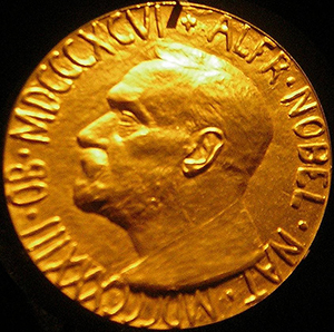 The obverse of a gold 1933 Nobel Peace Prize. This work is licensed under the Creative Commons Attribution-ShareAlike 3.0 License.