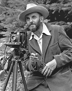 Photo portrait of photographer Ansel Adams (1902-1984), which first appeared in the 1950 'Yosemite Field School' yearbook. Image by Malcolm Greany. Image courtesy of Wikimedia Commons.