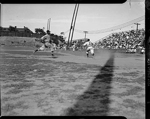 Charles 'Teenie' Harris; baserunner, possibly Homestead Grays baseball player, approaching home plate while catcher, uniform no. 2, awaits throw, during baseball game at Greenlee Field, circa 1938; Heinz Family Fund, 2001.35.3154 © 2006 Charles 'Teenie' Harris Archive, Carnegie Museum of Art, Pittsburgh.