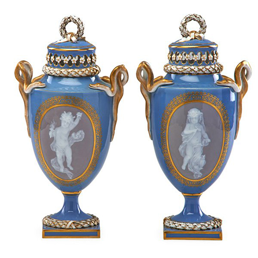 Pair of Meissen pate sur pate covered urns. Price realized: $16,250. Rago Arts and Auction Center image.